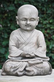 Un statut de Bouddha assis en lotus ou tailleur